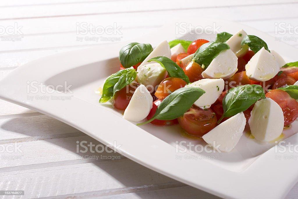 Tomato, mozzarella and fresh basil royalty-free stock photo