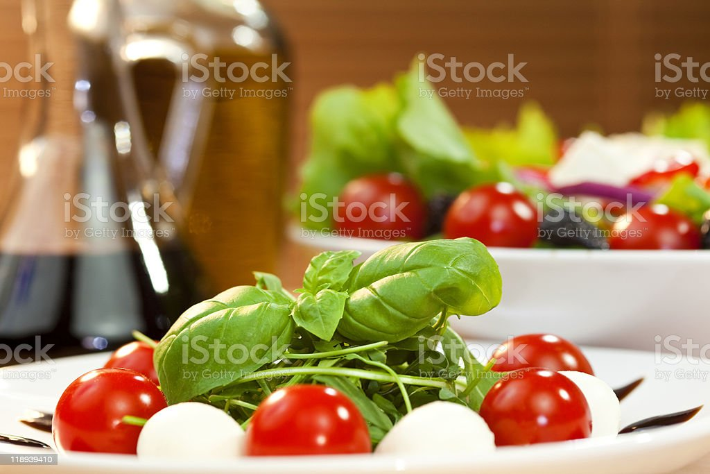Tomato Mozzarella Rocket Salad With Olive Oil and Balsmaic Vinegar royalty-free stock photo