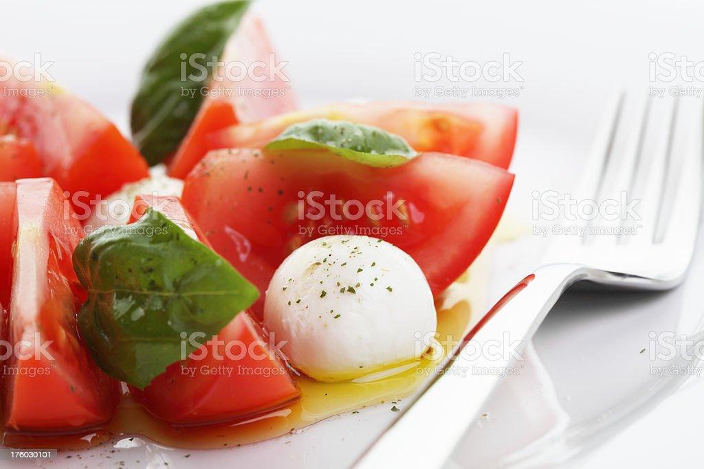 Tomato Mozzarella Salad with Basil Close-Up royalty-free stock photo