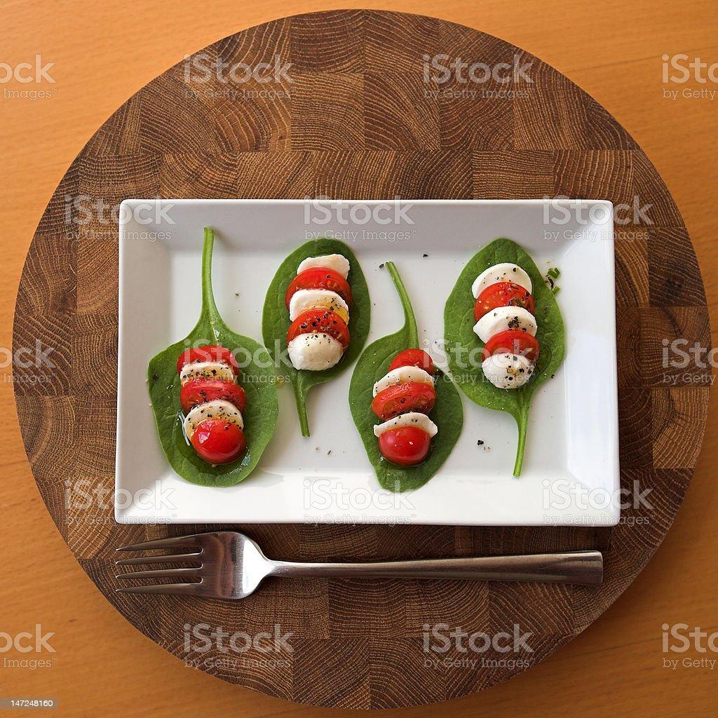 Tomato, mozzarella & spinach salad royalty-free stock photo