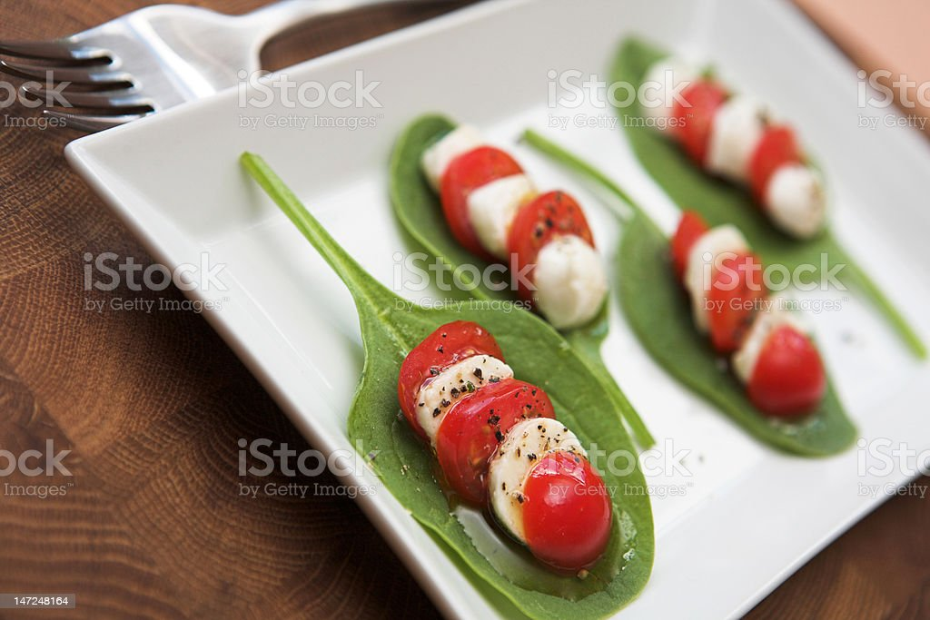 Tomato, mozzarella & spinach salad royalty-free stock photo