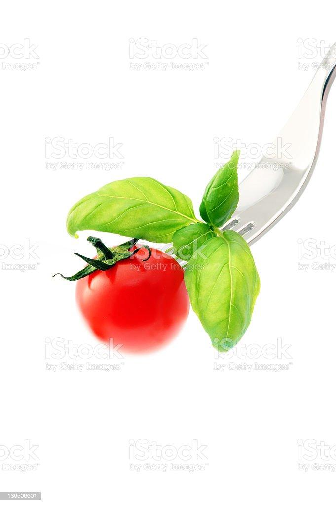 Tomate sur une fourchette photo libre de droits