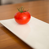 Tomato on glass plate