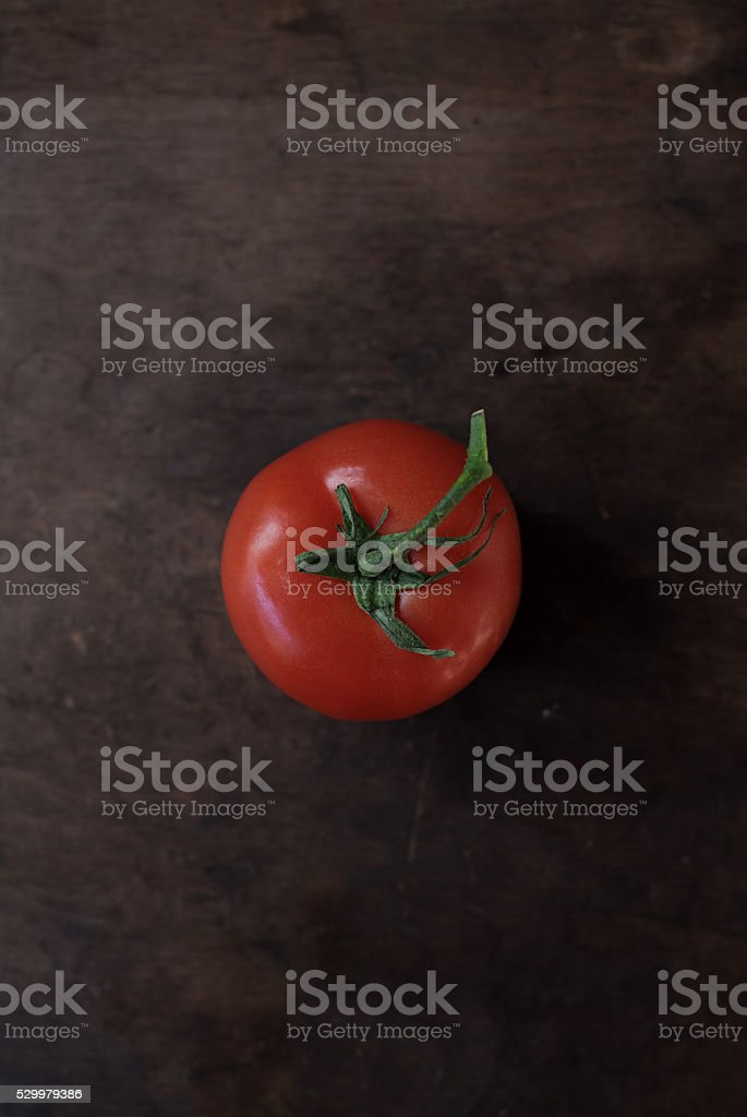 Tomato on vine wood backgrond stock photo