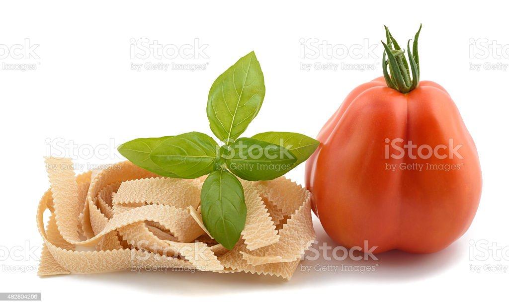 tomato pappardelle and basil stock photo