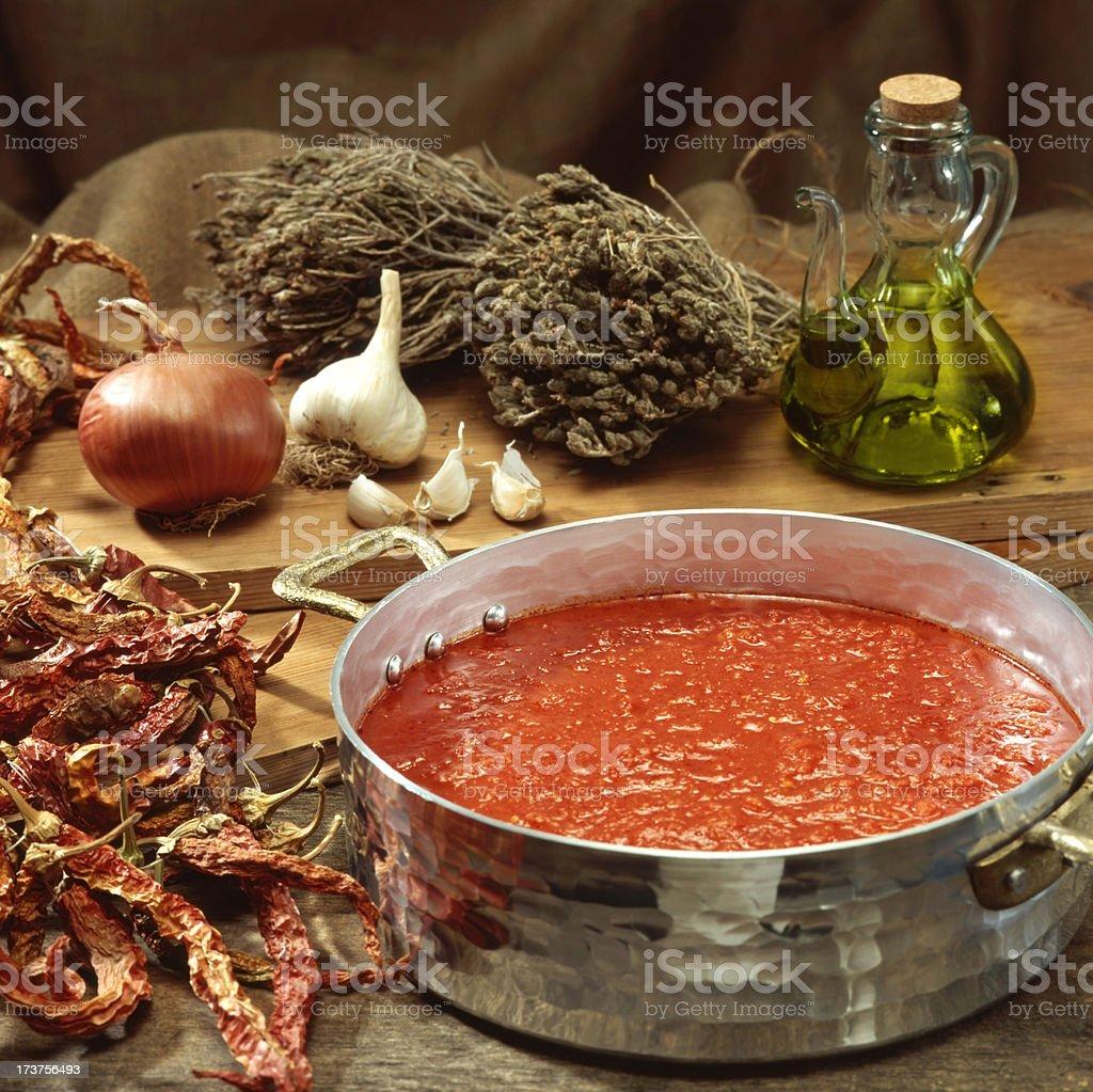 Tomato paste in saucepan stock photo
