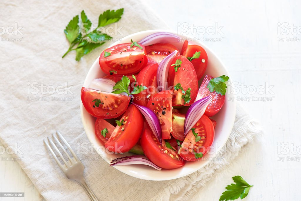 Tomato salad with onion stock photo