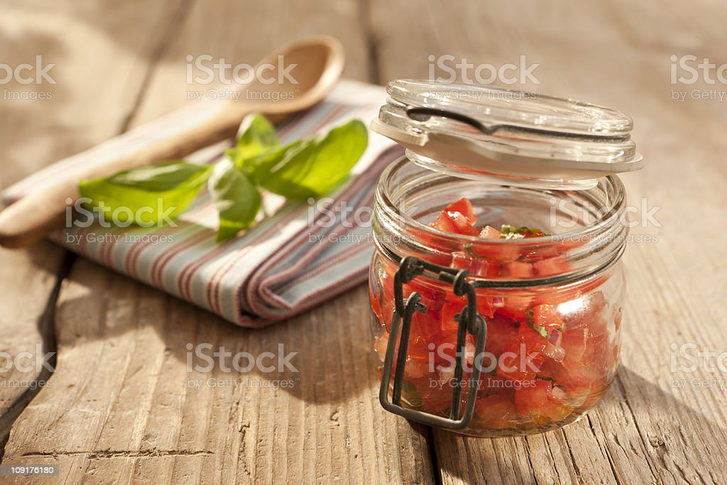 Tomato salsa in a canning jar royalty-free stock photo