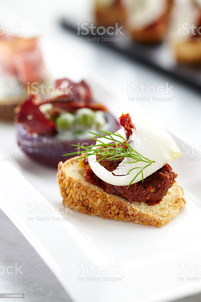 Tomato sauce and cheese on fresh bread stock photo