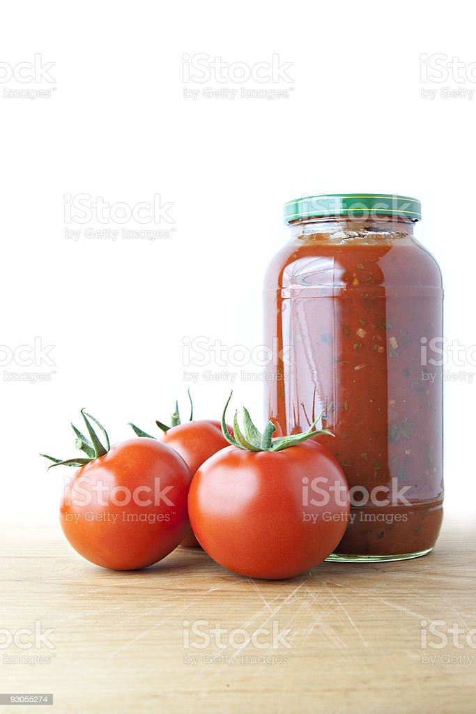 Tomato Sauce and Ripe Tomatoes on Wood royalty-free stock photo