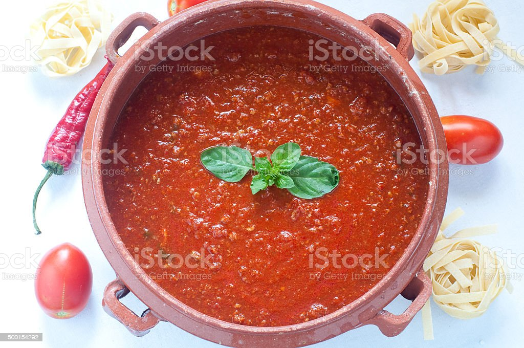 Tomato sauce in a clay pot stock photo