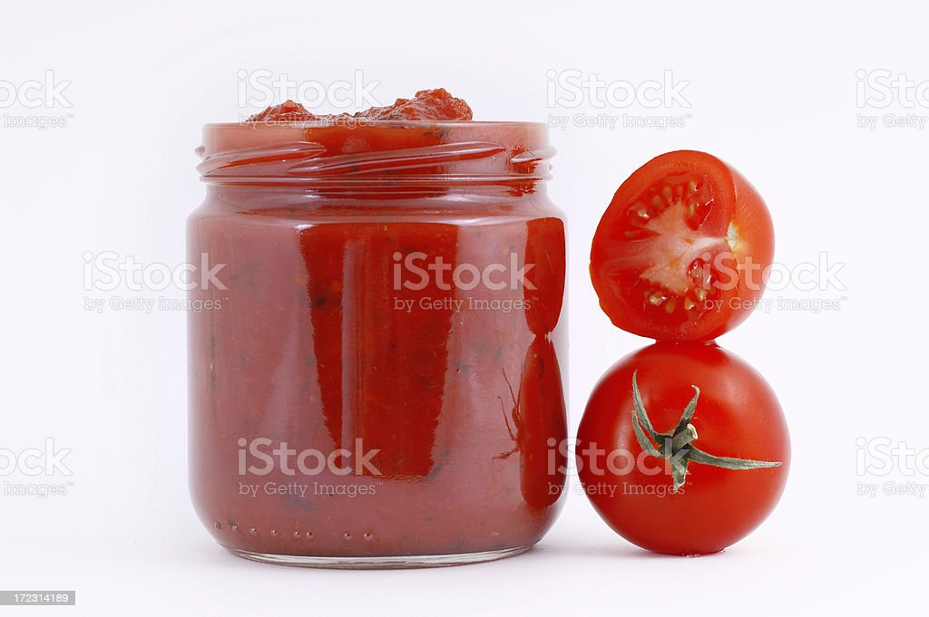 Tomato sauce in a container stock photo