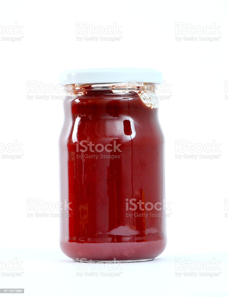 Tomato sauce jar on white background stock photo