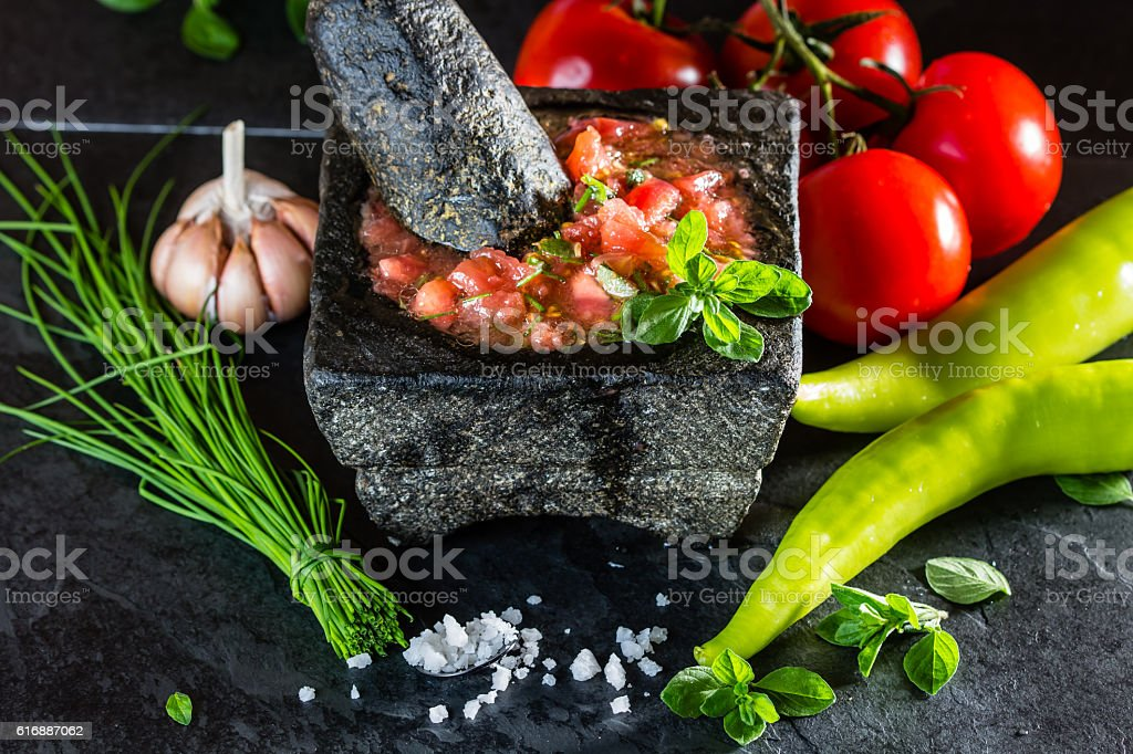 Tomato sauce salsa and ingredients dark stone background stock photo