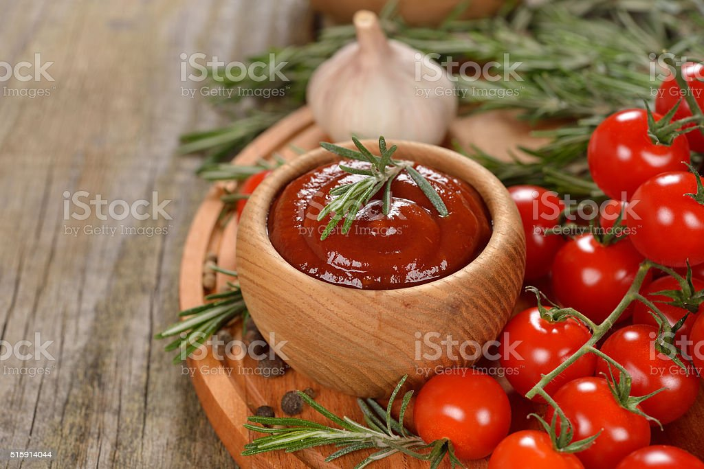 Tomato sauce with spices stock photo