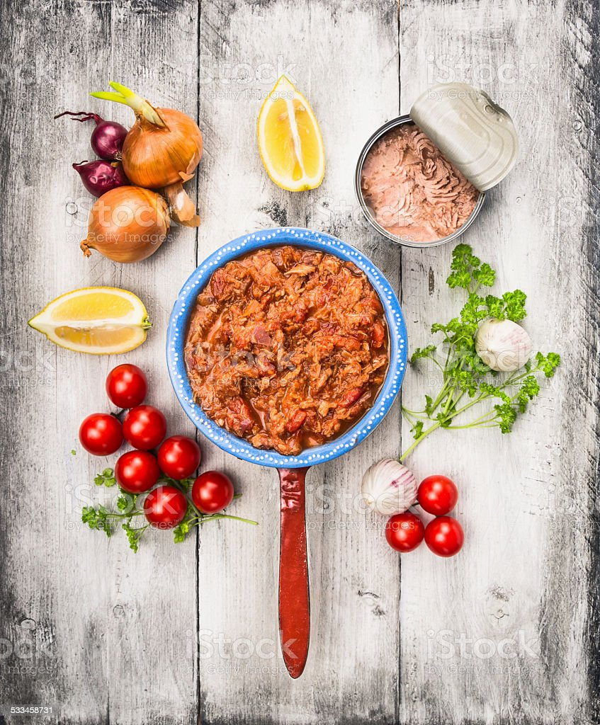 tomato sauce with tuna fish in porridge pot and ingredient stock photo