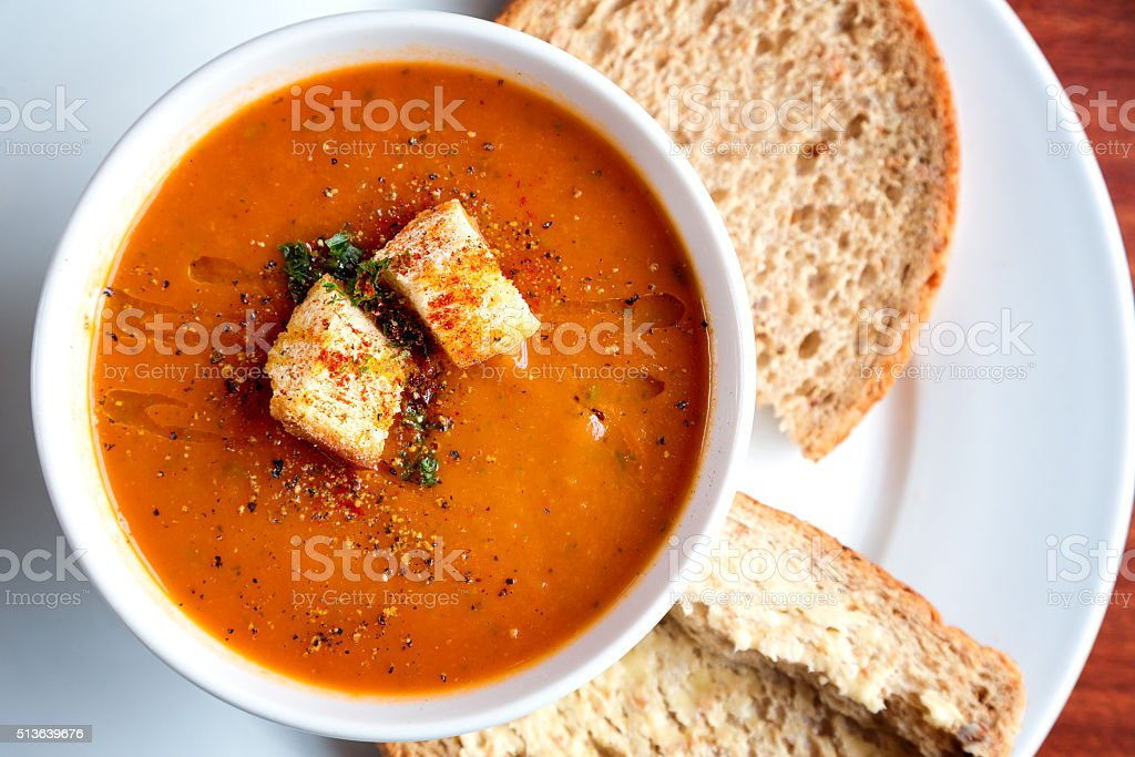Tomato soup and croutons stock photo