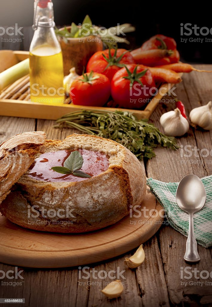 Tomato soup served in bread stock photo