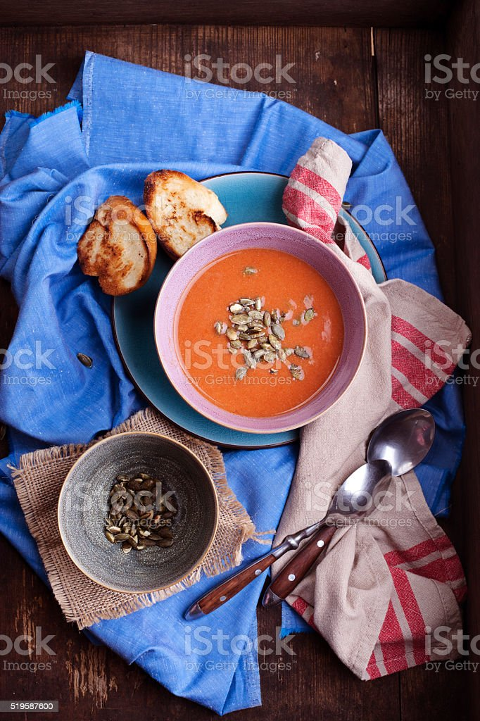 Tomato soup with cream and pumpkin seeds stock photo