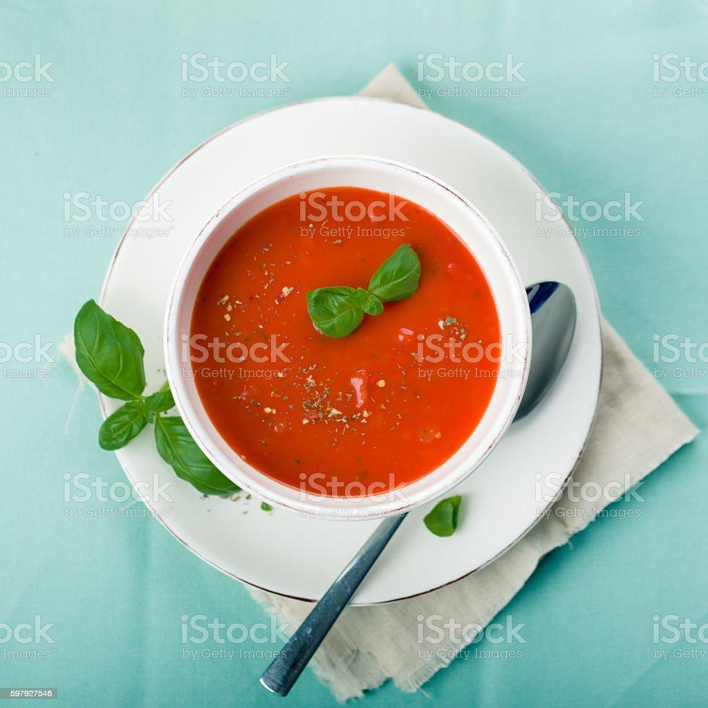 Tomato soup with fresh basil stock photo