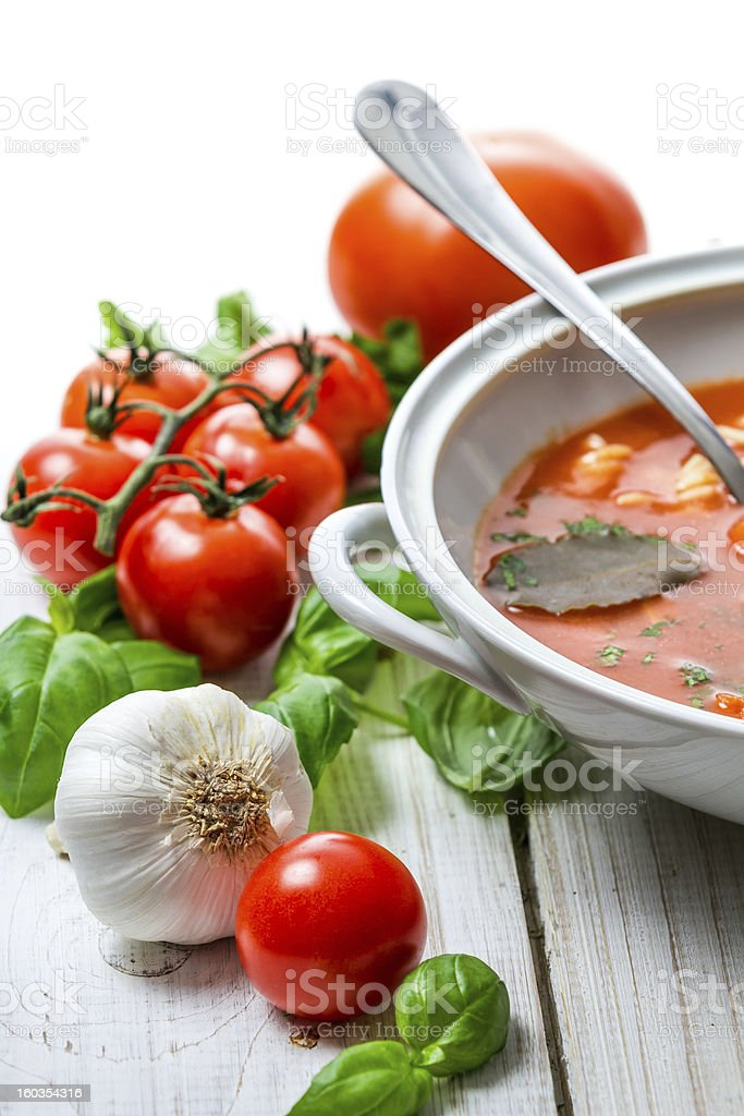 Tomato soup with noodles and fresh vegetables royalty-free stock photo