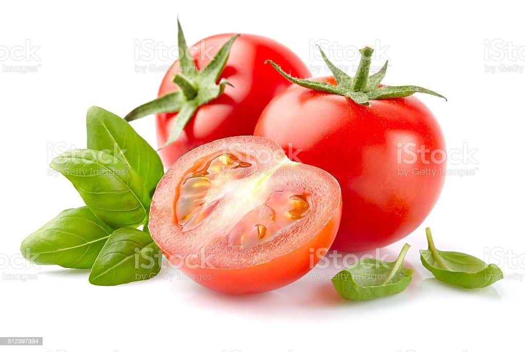Tomato with basil stock photo