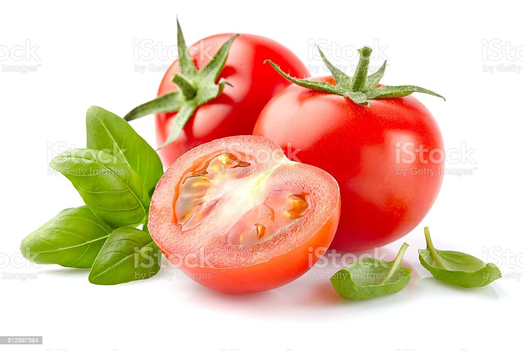 Tomato with basil stock photo