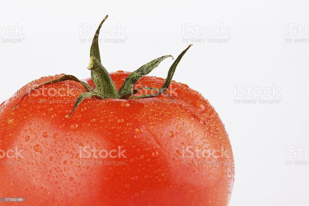 Tomato with dew drops stock photo
