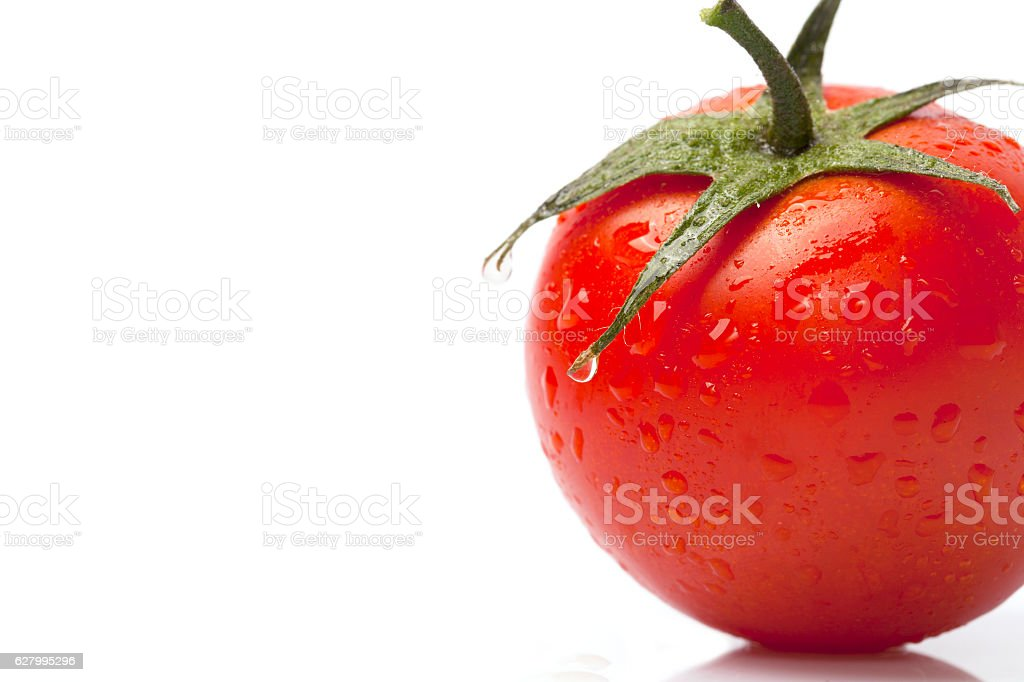 Tomato with drops isolated on white background stock photo