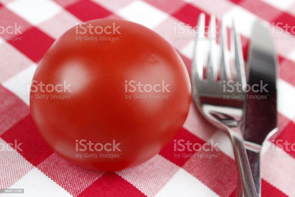 Tomato with fork and knife royalty-free stock photo