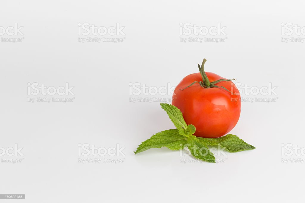 Tomato with fresh Mint leaves stock photo