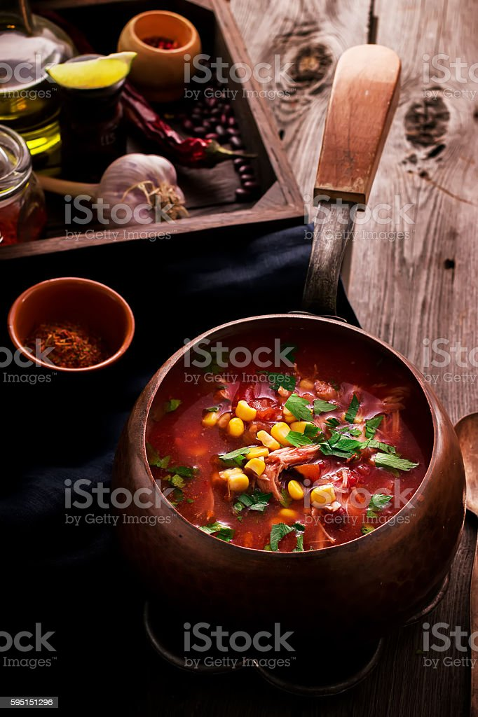 Tomatoe mexican soup with spices and lime on wooden table stock photo
