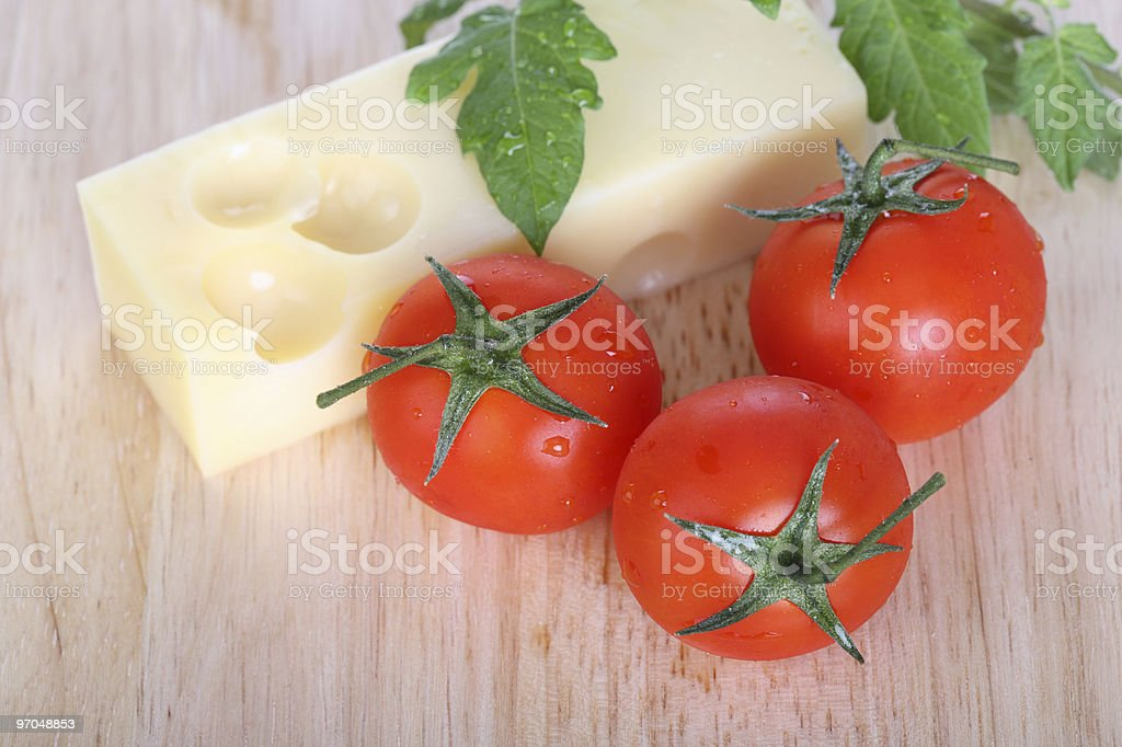 Tomatoes and Cheese Top View stock photo
