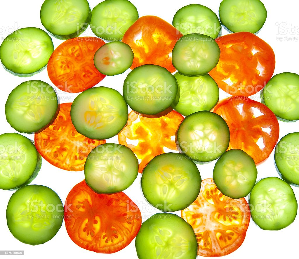 Tomatoes and cucumber - appetizing slices of vegetables royalty-free stock photo