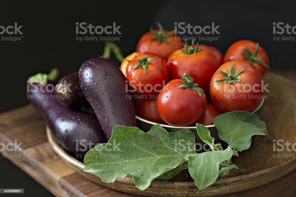 Tomatoes And Eggplants Still Life stock photo