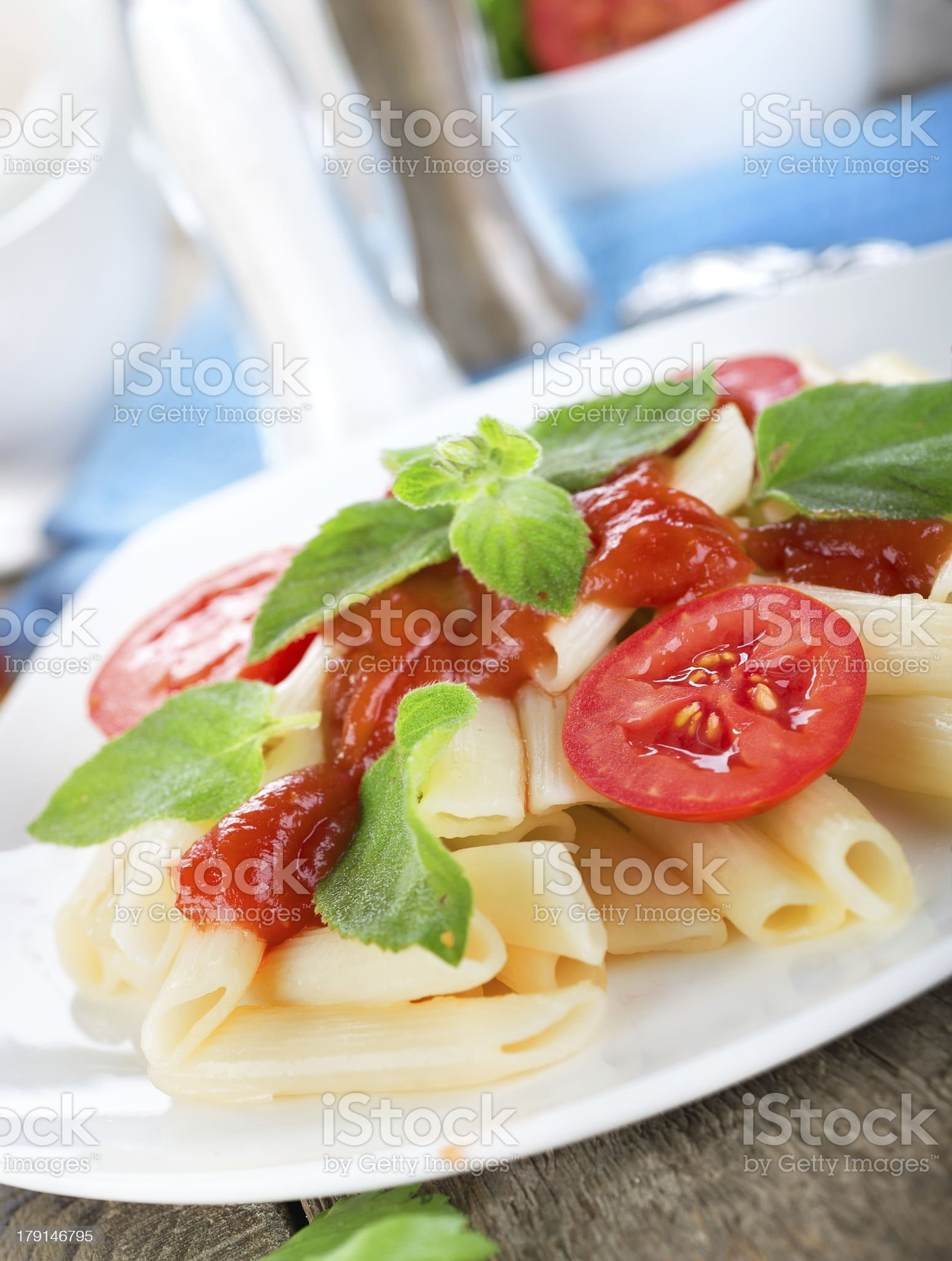 Tomatoes and ketchup on pasta royalty-free stock photo