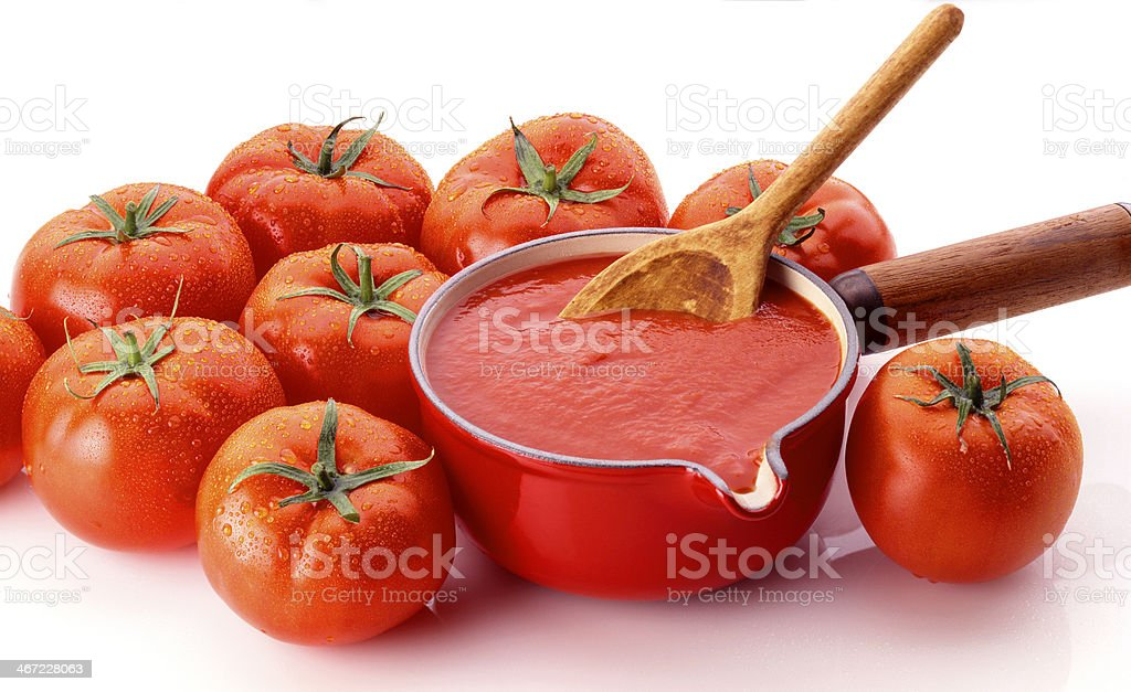 Tomatoes and sauce in pan stock photo