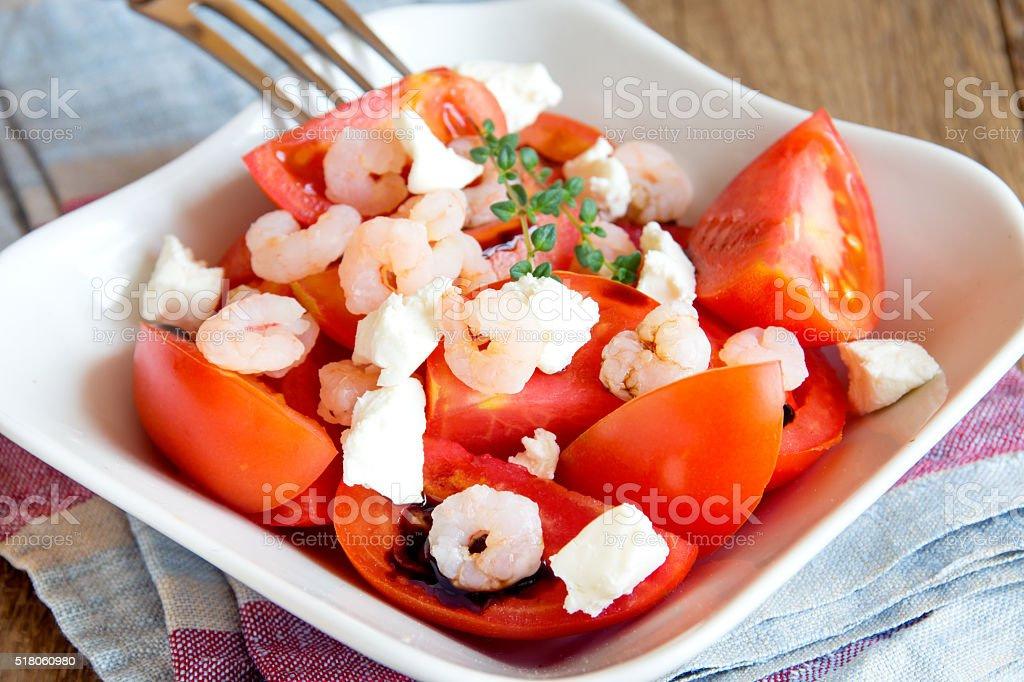 Tomatoes and shrimps salad stock photo