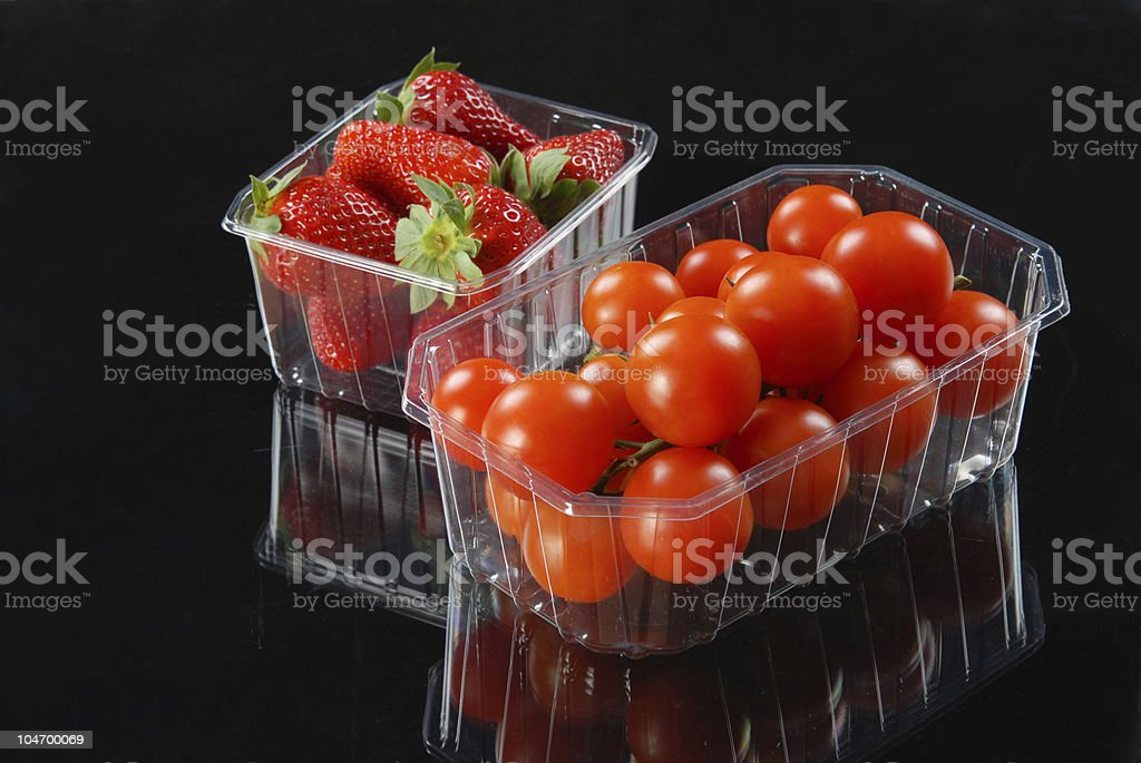 Tomatoes and strawberries stock photo