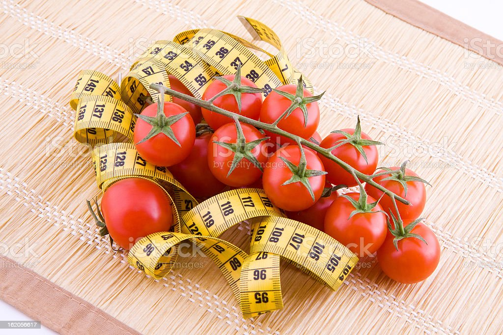 Tomatoes and tailor tape royalty-free stock photo