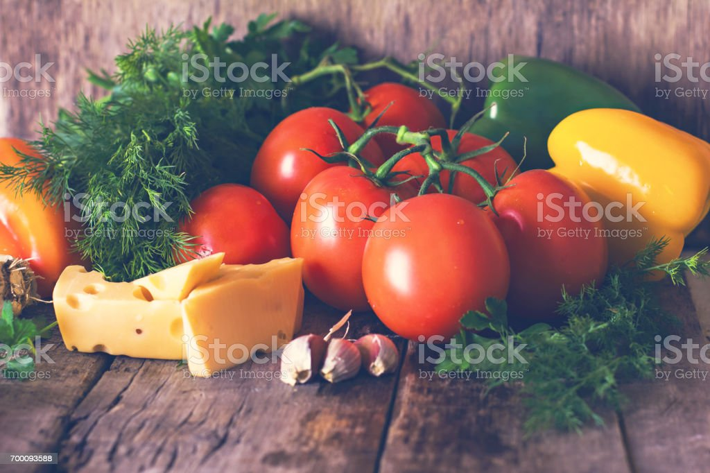 tomatoes, bell pepper, garlic, herbs and cheese stock photo