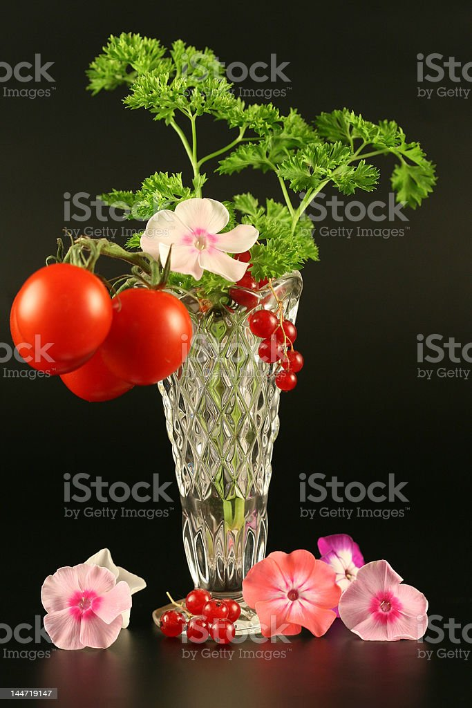 Tomatoes, currant  and flowers in a vase royalty-free stock photo