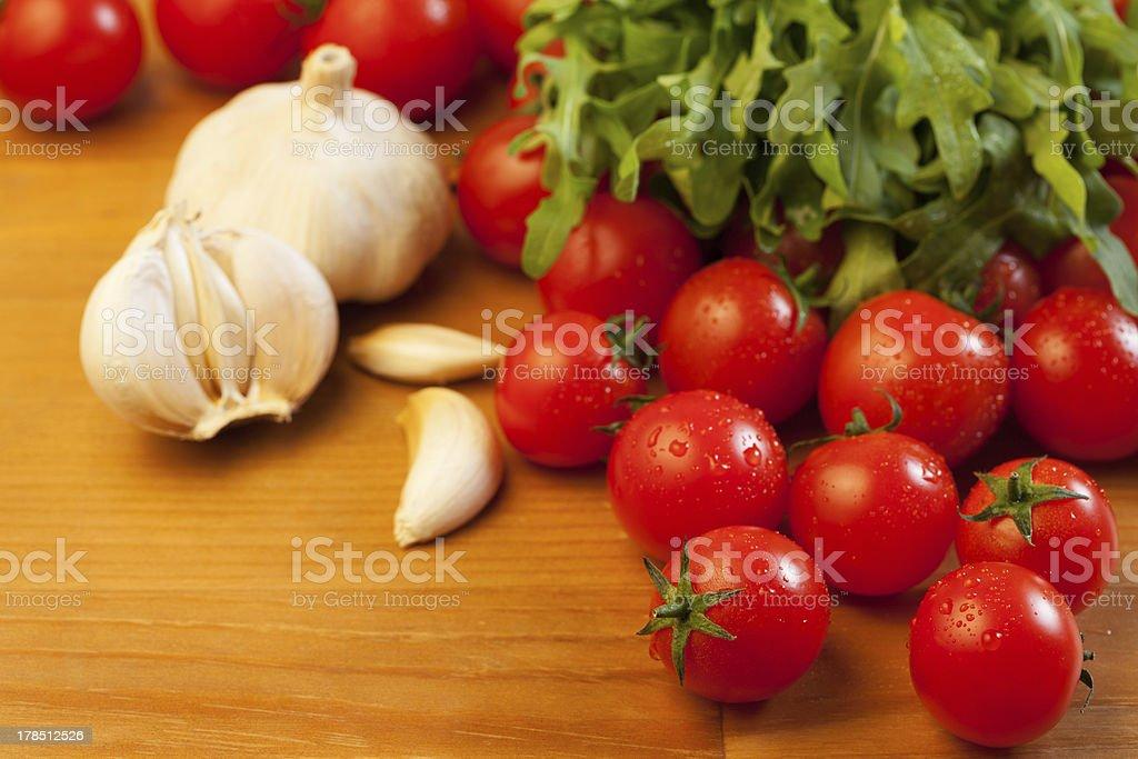 Tomatoes, garlic and rucola royalty-free stock photo