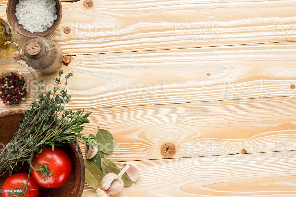 tomatoes, herbs, thyme, rosemary, sea salt, olive oil  top view stock photo