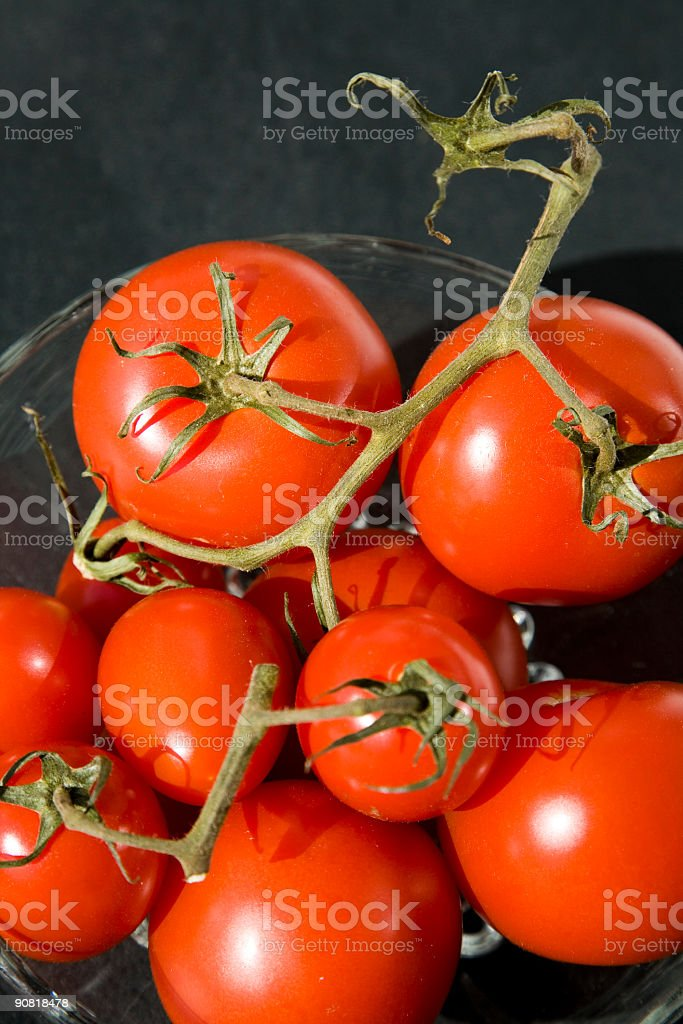 Tomatoes in a bowl royalty-free stock photo