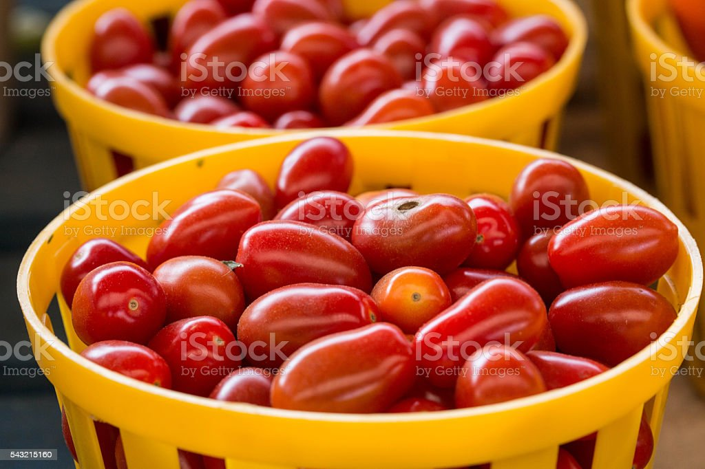 Tomatoes In Baskets At Farmers Market stock photo