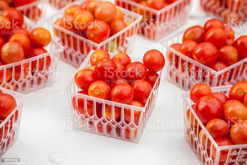 tomatoes in baskets stock photo