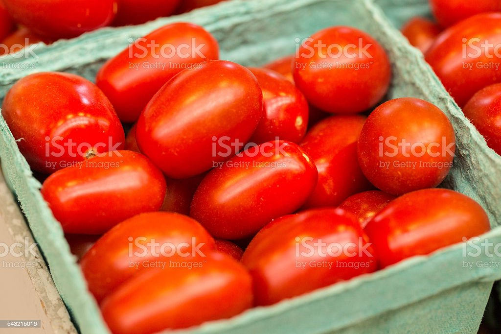 Tomatoes in Carton at Farmers Market stock photo