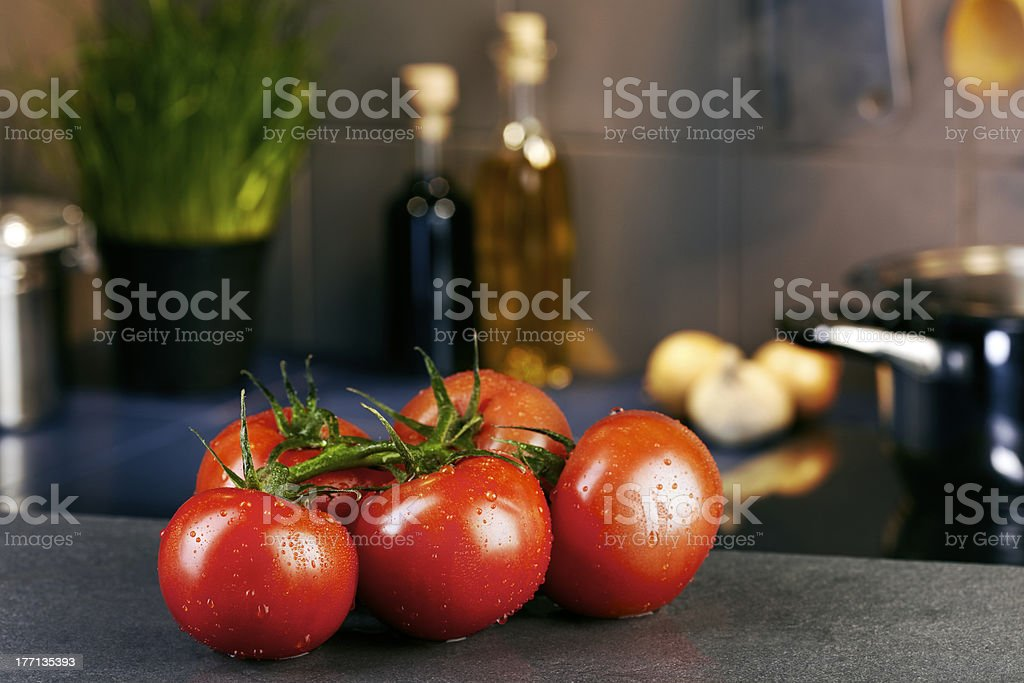 Tomatoes in front of a kitchen royalty-free stock photo