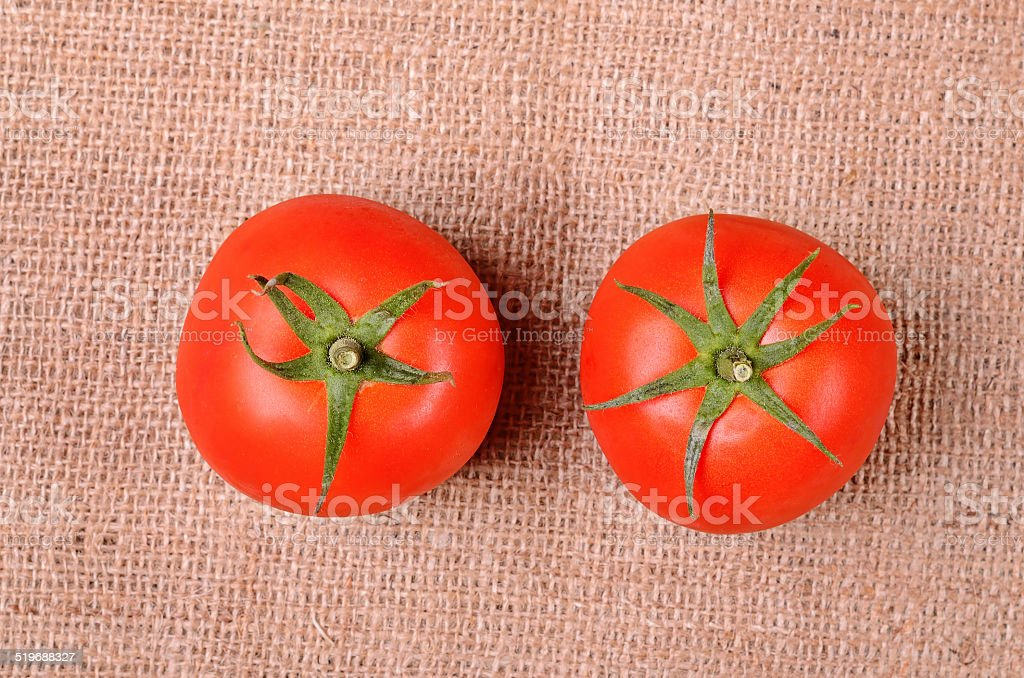 Tomatoes on a sackcloth background stock photo